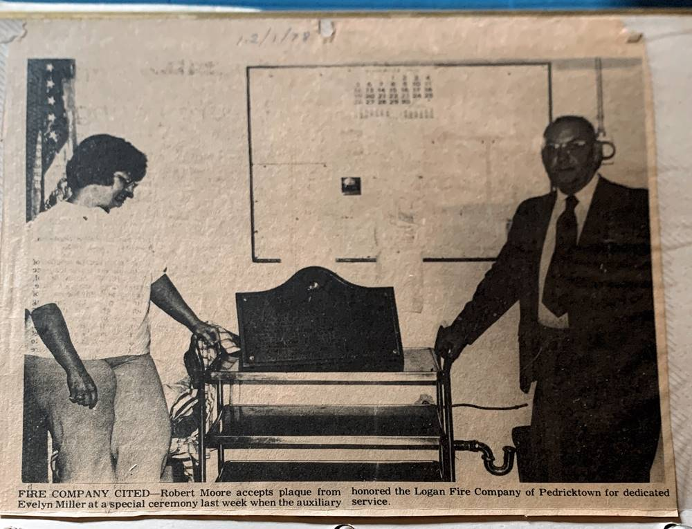 Newspaper clipping - Robert Moore accepts plaque