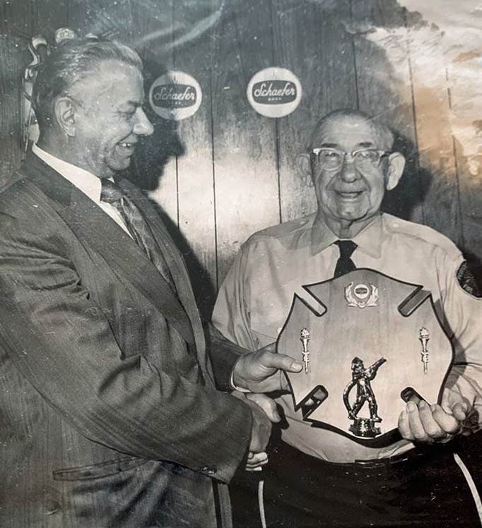 Old photo of Newkie Moore being honored.