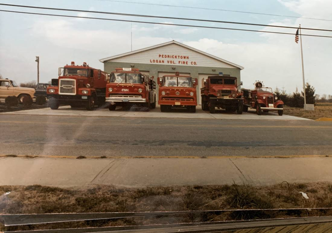 Straight on view of trucks in front of station