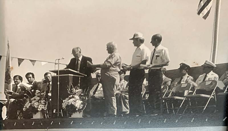 Dedication photo with group on stage