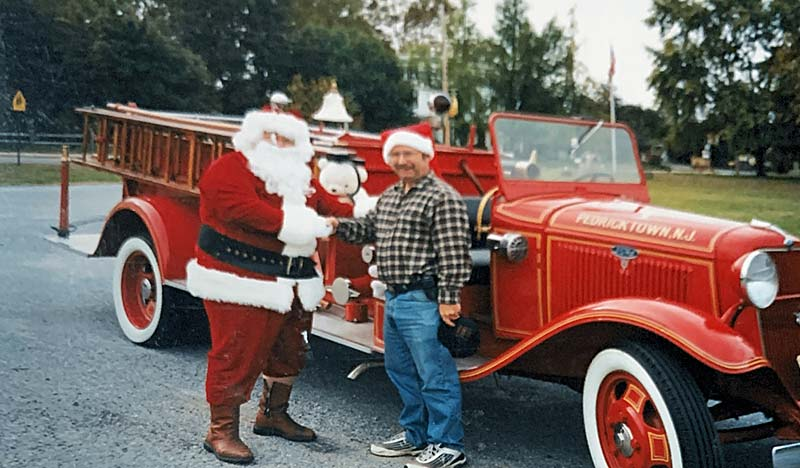 Santa with Gary Moore by antique firetruck