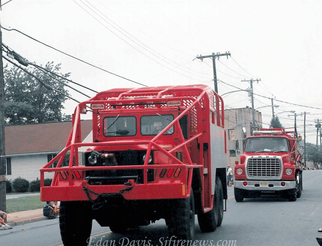 Brush 3-4 2005 driving on street with another firetruck behind