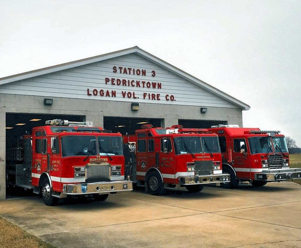Behicles parked in front of station house