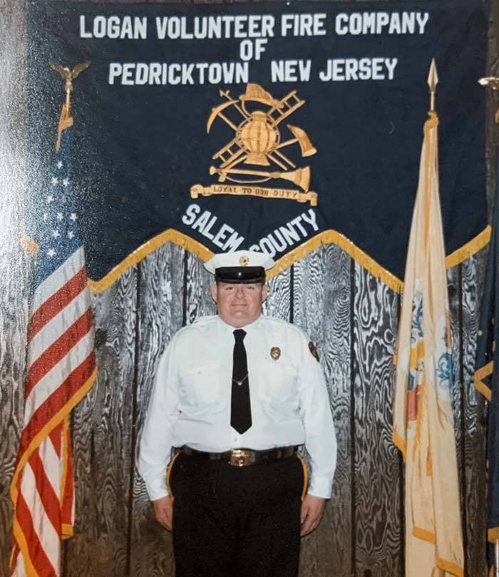 James Carty standing between flags