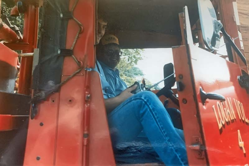 Two men in cab of firetruck