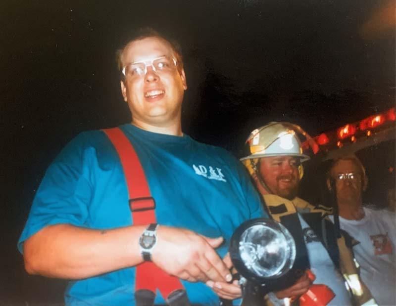 Firefighter holding flashlight