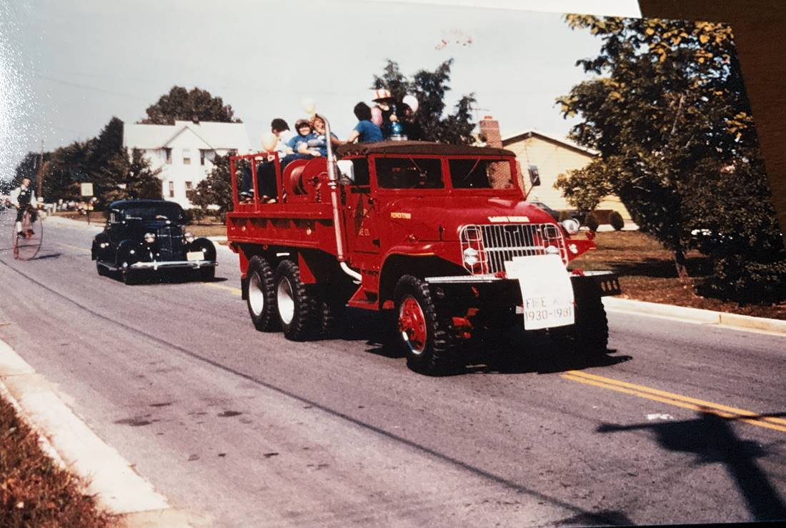 Vintage truck driving in parade
