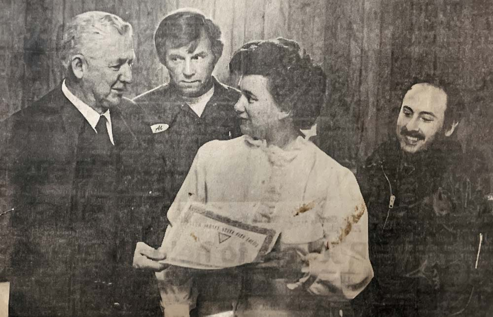 Old photo of a woman being presented with a recognition